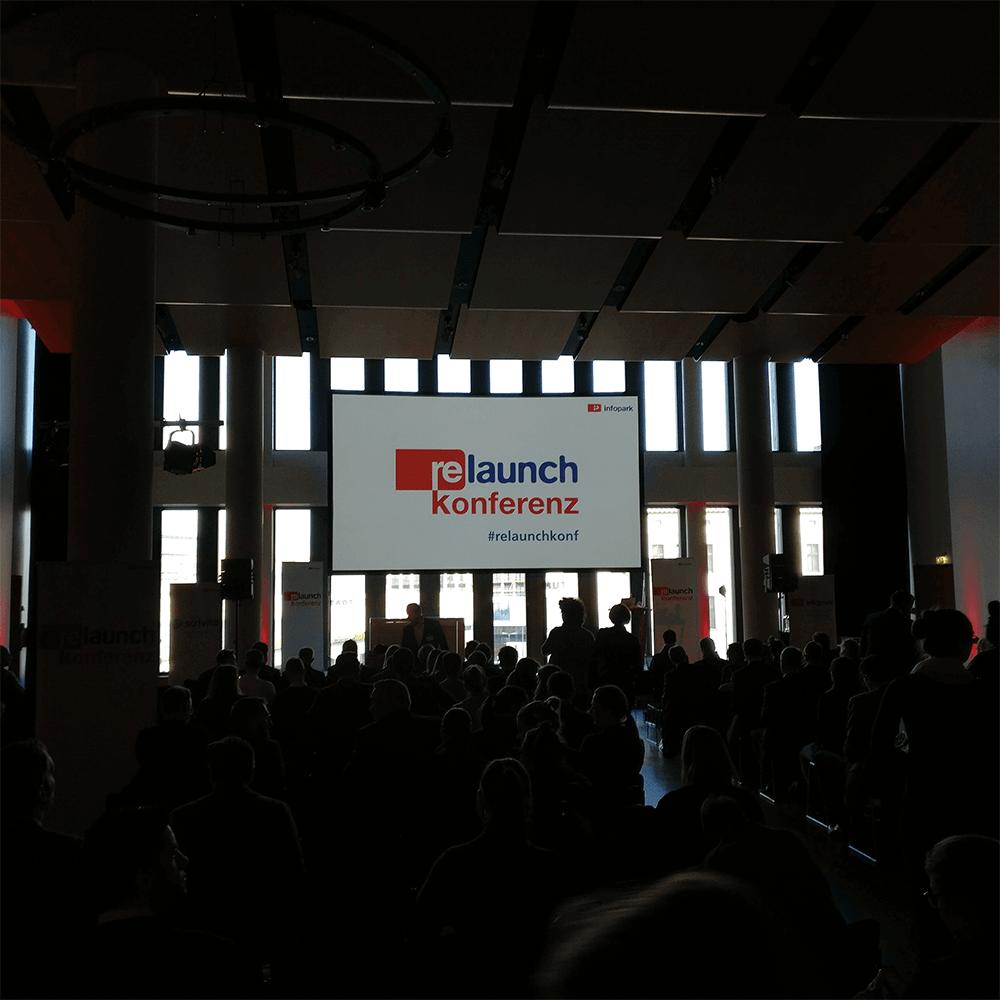 Bild: Begrüßung auf der Relaunch Konferenz